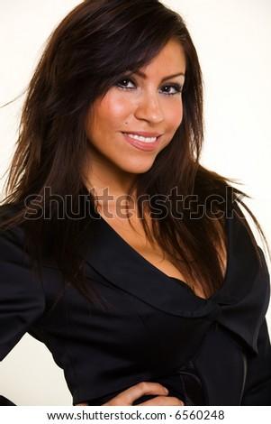 Head shot of a beautiful Hispanic hair woman smiling wearing a business jacket