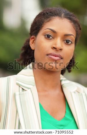 Head shot of a beautiful young black woman - stock photo
