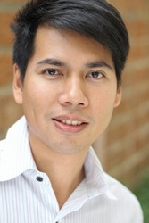 Head shot of handsome Asian business man smile outdoor.