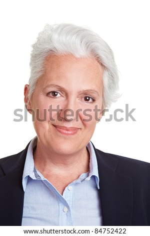 Head shot of smiling senior woman with grey hair