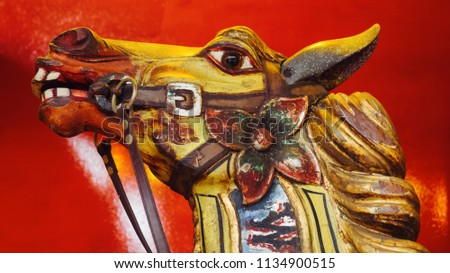 head shot of vintage wooden horse from carousel funfair ride