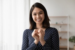 Head shot portrait close up smiling Asian woman showing heart gesture, expressing love, support and care, regular medical checkup promotion, cardiovascular diseases prevention, charity concept