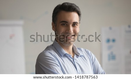 Head shot portrait confident positive employee middle aged businessman pose standing in office smile looking at camera. Motivation leadership career growth, successful startup project member concept