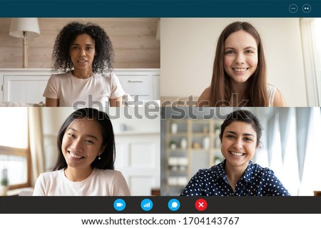 Head shot portrait four multiethnic millennial girls using video call application laptop webcam screen full frame view. Distant chat, virtual communication, modern technology, webinar activity concept