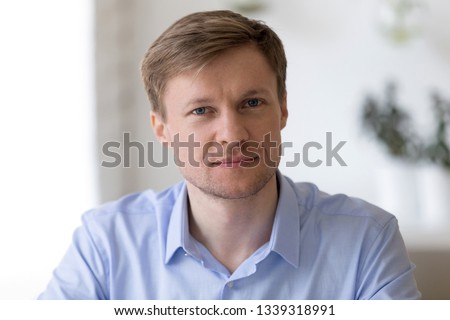 Head shot  portrait of smiling middle aged businessman sitting at work desk looking in camera Successful company executive manager posing at workplace, feeling confident and satisfied, profile picture