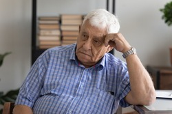 Head shot unhappy pensive mature man lost in thoughts, looking to aside, grieving, sad upset senior male thinking about health problems, feeling lonely and depressed, elderly and solitude concept