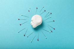Headache concept, needles surround head. Pain and stress, migraine.