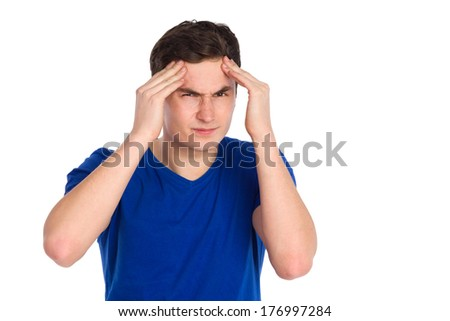 Headache, hangover. Close up of young man massaging head in pain. Waist up studio shot isolated on white.
