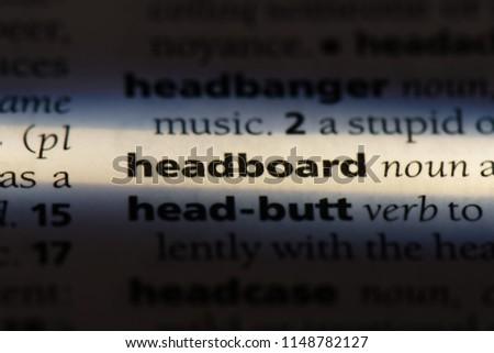 headboard word in a dictionary. headboard concept. #1148782127