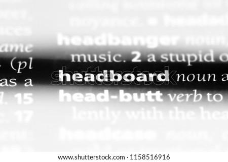 headboard word in a dictionary. headboard concept. #1158516916