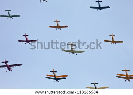 HEADCORN, UK - AUGUST 11:A formation of private light aircraft give a tight formation display to the public at the Combined Ops show on August 11, 2012 in Headcorn