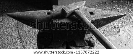 header for social old anvil with hammer on wooden log
