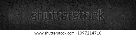header panorama black concrete uneven cracked background. fits background for text or calligraphy. stone texture