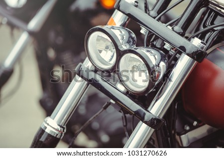 headlamp of a classic motorcycle, stylish front view, close-up. #1031270626