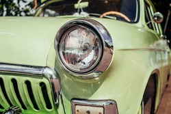 Headlamp of tuned old vintage car, close up. Low rider auto.