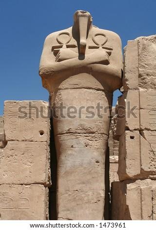 Headless and Legless in Egypt. Pharoah clutches Key of Life at Karnak Temple.
