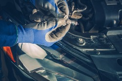Headlight Bulb Repair and Maintenance in the Auto Service. Maintaining Car Lightning. Repair Vehicle Concept.