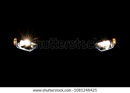 Headlight car in dark background #1081248425