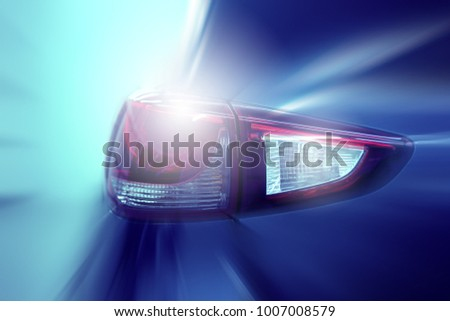 Headlight car modern car headlight detail.motion blurred.selective focus. #1007008579