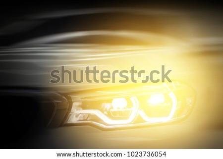 Headlight car.modern car headlight detail.motion blurred.selective focus. #1023736054
