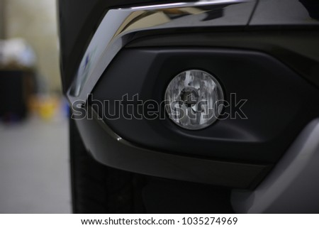 Headlight car.modern car headlight detail.selective focus. #1035274969