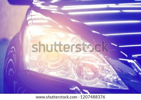 Headlight car modern car headlight detail.selective focus. #1207488376