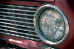 headlight of a vintage car. old car of red color. vintage car body