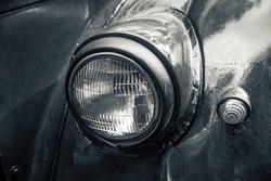 Headlight of an old car close up.