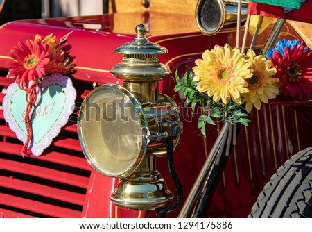 Headlight of an Old Classic Car Adorned with Flowers #1294175386