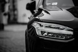 Headlight of black car. Led car headlight