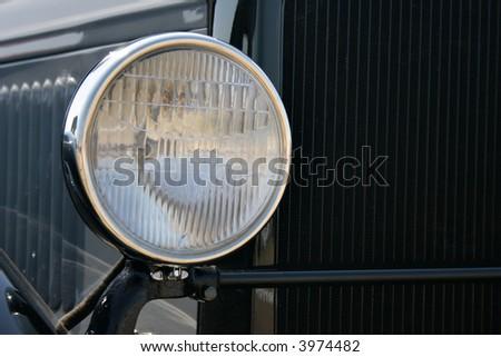 Headlight of black retro car close-up #3974482