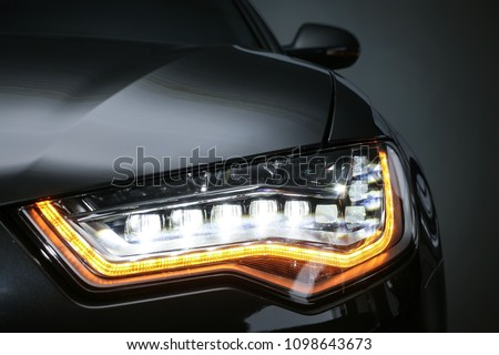 headlight of  modern prestigious car closeup #1098643673