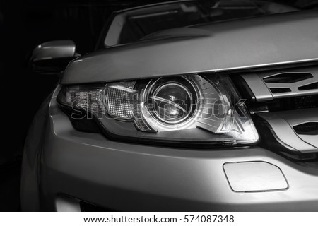 Photo of headlight of  modern prestigious car closeup
