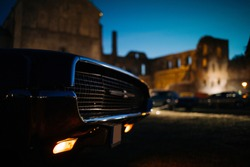 Headlight of old classic car at night