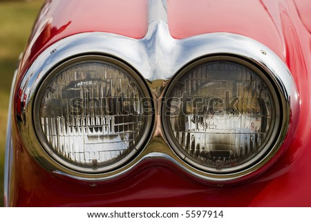 Headlight on a red american car