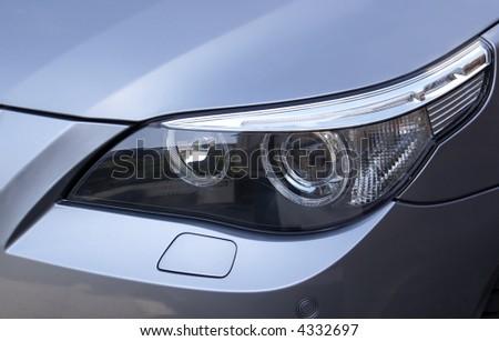 Headlight on a silver metallic BMW