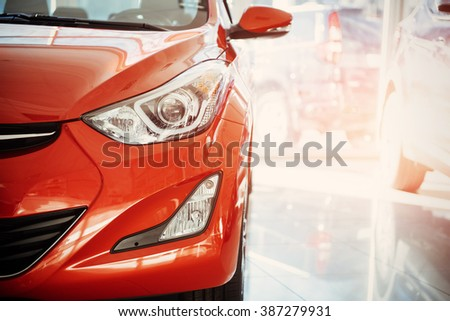 Headlights and hood of sport red car #387279931