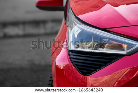 Headlights and hood of sport red car with silver stars. Car detail Сток-фото ©