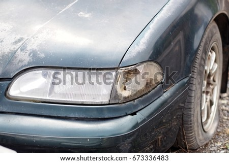 Headlights from old cars cracked because of accidents. #673336483