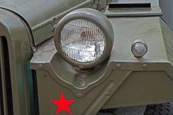 Headlights of an retro military vehicle during World War II.