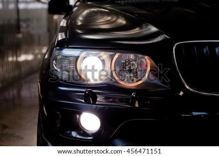 headlights of black car. Garage theme