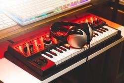 headphone on keyboard synthesizer keys. music concept
