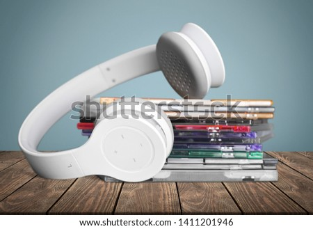 Headphones and compact discs  isolated   on background