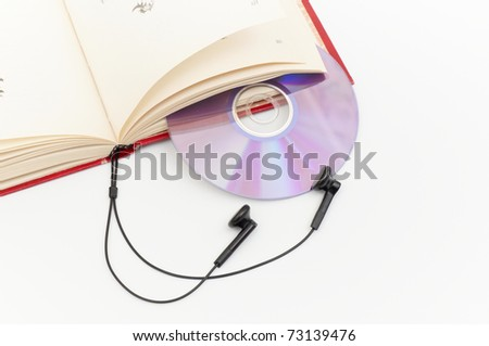 headphones and red books (audio book concept)