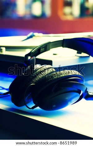 Headphones and turntable with cross-process color effect.