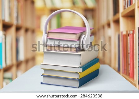 Headphones, Book, Audio Equipment.