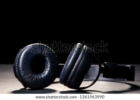Headphones in the spotlight. The concept of music and bloggers. May illustrate a streaming report. #1361963990
