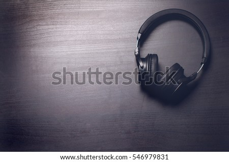 Stock Photo Headphones on a dark background. Music accessories. Blue-tooth headphones without cable.