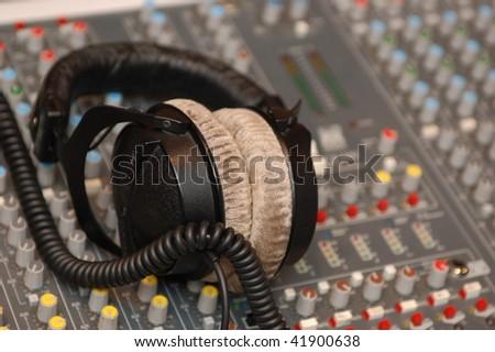 headphones on Audio Mixing Board Sliders