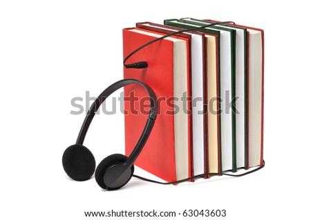 Headphones on books isolated on white background